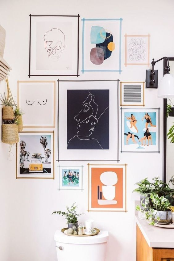 12 Ways To Display Your Gallery Wall - Taped Wall