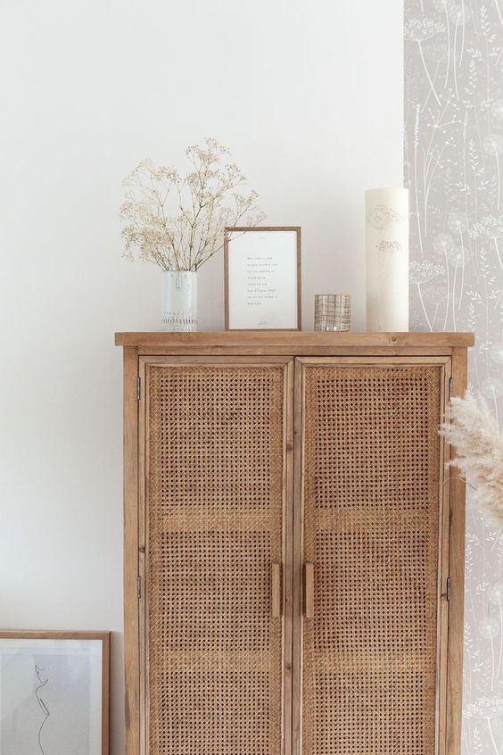 Natural rattan panelled cupboard