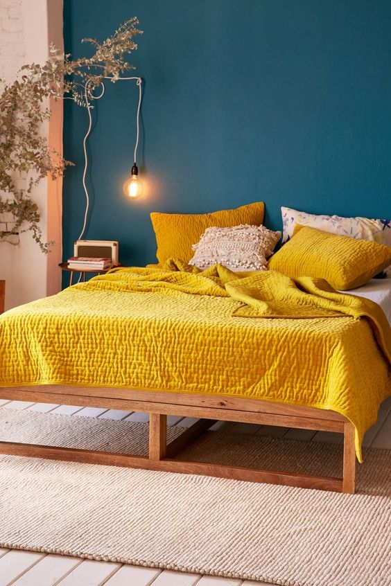 10 Rooms With Colour Done The Right Way! Teal-Backdrop-Bedroom-with-Yellow-Bed-Spread