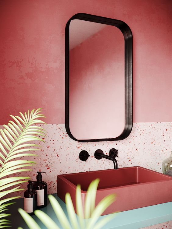 Two tone coral bathroom wall with terrazzo finish
