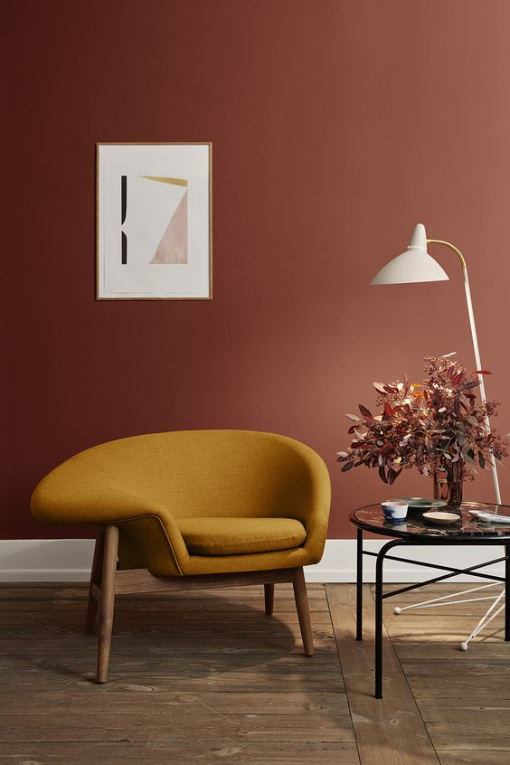 Autumn seasonal warm toned interior with terracotta and mustard and rustic wooden floors