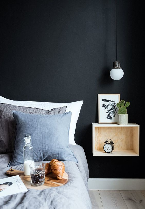 Bedroom design with ceiling pendant light over night stand