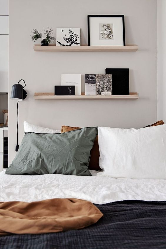 Picture ledge display wall a space saving trick for a smaller bedroom