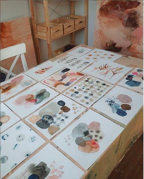 Laura Horn's art work spread over her work table
